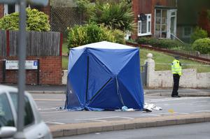 A forensics tent at the scene of the incident (Steve Parsons/PA)