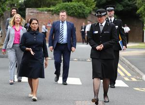 Home Secretary Priti Patel (second left) with Chief Constable of Sussex Police Jo Shiner (right) during a visit to Sussex Police Headquarters (Gareth Fuller/PA)