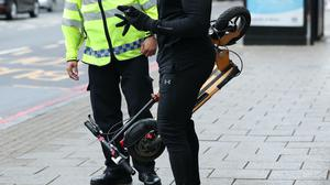 E-scooters are not allowed on UK public roads and pavements (Yui Mok/PA)
