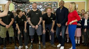 Prince Harry takes part in the filming of an episode of the Sky Sports 'Game Changers' television show dedicated to the Invictus Games flanked by (left to right) competitors Mary Wilson and Stuart Robinson and presenters Darren Campbell and Di Dougherty at Lambs Lane Primary School in Spencers Wood, near Reading.