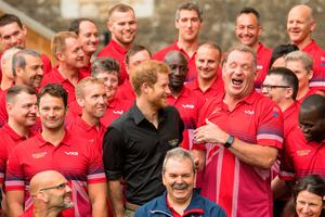 Prince Harry jokes while posing for a group photo with athletes as he attends the launch of the UK's Invictus Games team at the Tower of London. The games take place in Toronto, Canada, in September