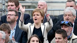 First Minister Nicola Sturgeon watches a match at the Homeless World Cup with Mel Young, right (Jane Barlow/PA)