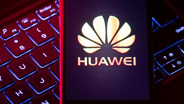 The Huawei logo is displayed on a smartphone screen, as the UK government is set to decide to what extent Chinese tech giant Huawei will be allowed to help build new 5G infrastructure.
