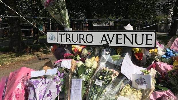 Floral tributes left at the scene where a 30-year-old man died after a car was driven into a group of people (Pat Hurst/PA)