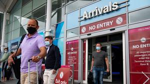 Travellers flying back to the UK after the announcement on quarantine requirements (Jacob King/PA)
