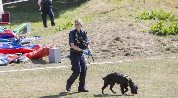 Police search in Jubilee Park, Edmonton, following the fatal stabbing of a 29-year-old man (Rick Findler/PA)