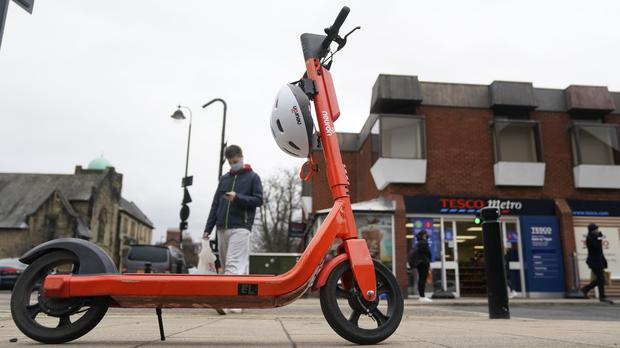 The orange hire scooters are part of a new scheme in Newcastle (Owen Humphreys/PA)