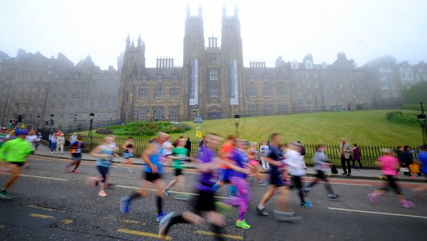 Fog coated the city centre buildings, proving ideal conditions for the Edinburgh marathoners (Jane Barlow/PA)