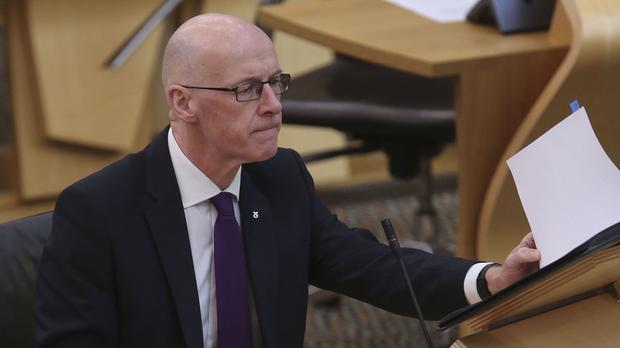 Deputy First Minister John Swinney pledged that every pupil would get an electronic device to help their studies (Fraser Bremner/Scottish Daily Mail/PA)