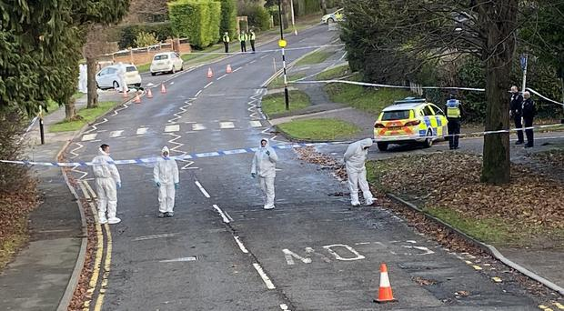 Forensic officers in Wellingborough Road in Rushden (Northants Police Search Team/PA)