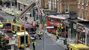 A double-decker bus has crashed into a shop in London high street (Brendan Pfahlert/PA)