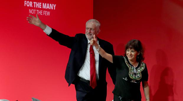 Labour leader Jeremy Corbyn with his wife Laura Alvarez after speaking at the party's annual conference in Brighton (Gareth Fuller/PA)