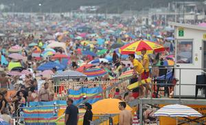 People enjoy the hot weather at Bournemouth beach (Andrew Matthews/PA)