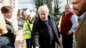 Prime Minister Boris Johnson visits Bewdley in Worcestershire to see recovery efforts following recent flooding in the Severn valley and across the UK (Peter Nicholls/PA)
