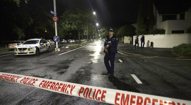 A police officer at a cordon near a mosque in central Christchurch (AP Photo/Mark Baker)