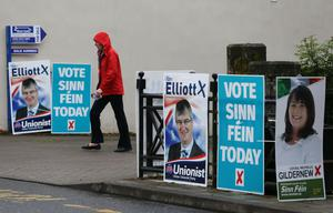 A voter leaving Brookeborough Primary School, Co Fermanagh, having cast a vote (Brian Lawless/PA)