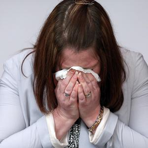 Rebecca Rigby, the wife of murdered soldier Lee Rigby, wipes her eyes during a family press conference in Bury, Greater Manchester