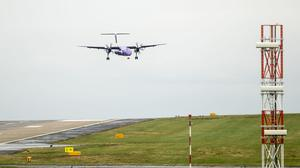 A police helicopter monitored flights into Leeds Bradford Airport after two reports of lasers being used (Danny Lawson/PA)
