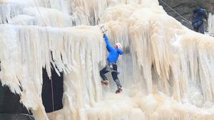 People ice climb on the frozen Kinder Downfall, High Peak in Derbyshire (Danny Lawson/PA)