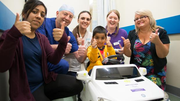 Gavy Saini, centre, with his mother, from left, Sundeep Saini, Jim Morrissey, Advanced Theatre Practitioner, Sophie Winstanley, Student Nurse, Abigail Hanlon, Play Specialist and Amanda Winwood, fundraising manager for Your Trust Charity. (Sandwell and West Birmingham Hospitals NHS Trust/PA)