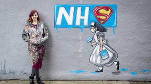 Artist Rachel List with her mural supporting the NHS on the side of Horse Vaults pub in Pontefract, Yorkshire (Danny Lawson/PA)