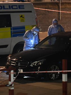 Police activity near the junction of Grafton Road and Vicars Road after the fatal stabbing (John Stillwell/PA)