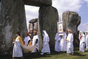 People wearing white robes during a procession in 1981 celebrating the Midsummer Solstice at Stonehenge (PA)