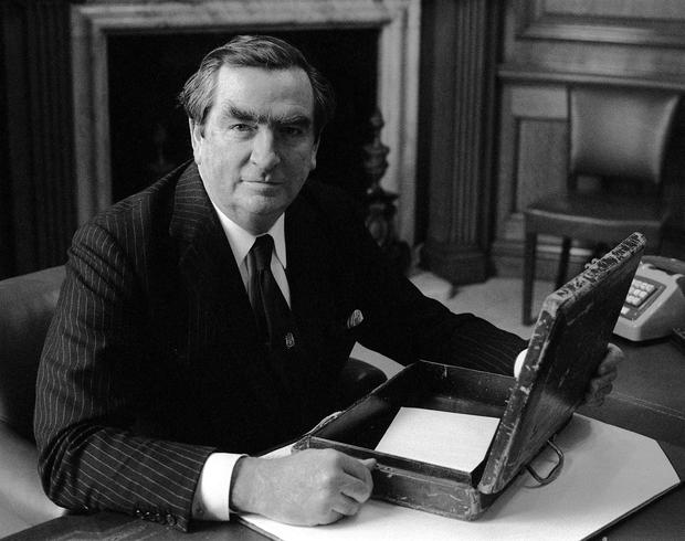 Denis Healey with the traditional red briefcase, in which successive chancellors have carried their Budget speech from Downing Street to the House of Commons (PA)