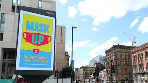 Manchester City Council advertising regarding the guidelines on wearing masks on a billboard in Manchester (Peter Byrne/PA)