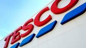 Tesco is set to cut its opening hours, it is understood (Nick Ansell/PA)
