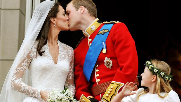 William and Kate kiss on the balcony of Buckingham Palace (PA)