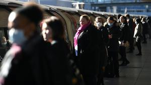 Public transport users should face away from each other when they cannot keep a two-metre gap, the Government has said (Victoria Jones/PA)