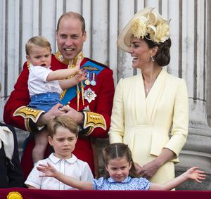 William and Kate with their children, Prince Louis, Prince George and Princess Charlotte, on the balcony of Buckingham Place (Victoria Jones/PA)
