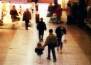A video still of toddler James Bulger being led away in the New Strand shopping centre in the Bootle area of Liverpool (PA Wire)