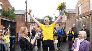 Keith Farquharson celebrates after completing his epic ride (Sir Bobby Robson Foundation/PA)