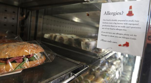 An allergy warning notice displayed next to food in a branch of Pret A Manger in central London (PA)