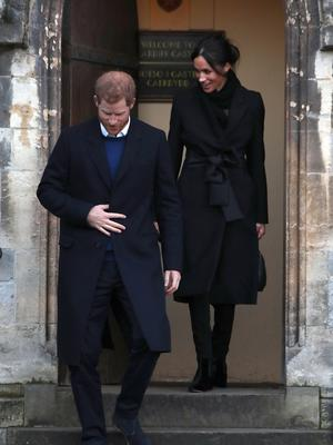 Meghan Markle wears a black coat by Stella McCartney while visiting Cardiff Castle with Prince Harry (Andrew Matthews/PA)