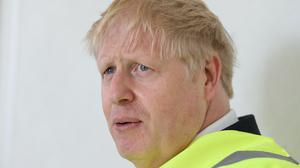 Prime Minister Boris Johnson, sporting a new haircut, during a visit to the Siemens Rail factory construction site in Goole (Peter Byrne/PA)