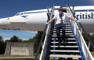 A volunteer cleans the steps leading down from Concorde at Brooklands Museum (Andrew Matthews/PA)