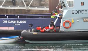 A group of people thought to be migrants are taken into Dover on board a Border Force boat (Gareth Fuller/PA)