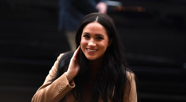 The Duchess of Sussex arrives for her visit to Canada House (PA)