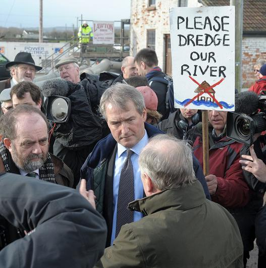 Environment Secretary Owen Paterson (centre) visiting Northmoor Pumping Station in Somerset