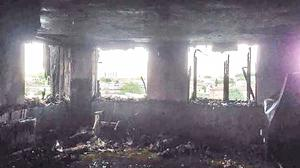 Daylight reveals the devastation caused to one of the flats