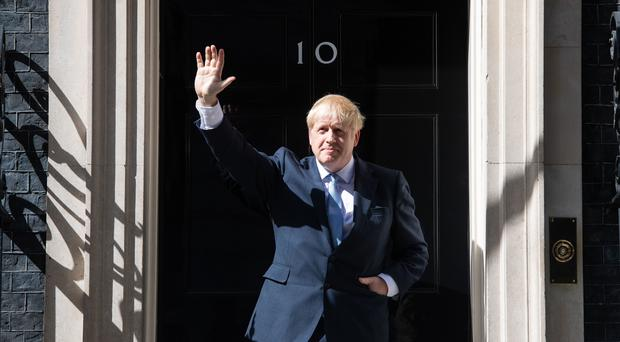 Boris Johnson waves on the steps of 10 Downing Street after becoming Prime Minister (Dominic Lipinski/PA)