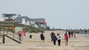 People on the beach at Camber Sands in East Sussex (Gareth Fuller/PA)