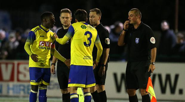 Haringey players talk with the ref (Steven Paston/PA)