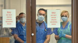 Medical staff wearing personal protective equipment (Jacob King/PA)
