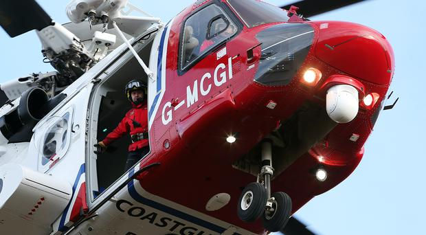 A coastguard helicopter is involved in the evacuation (Andrew Milligan/PA)