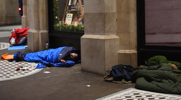 Homeless people in central London (Victoria Jones/PA)