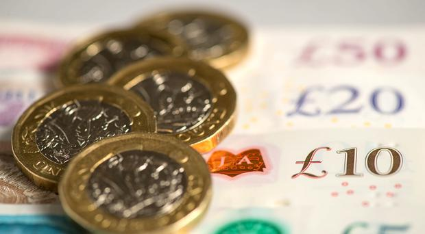 Pay rises are forecast to fall in the coming year (PA)